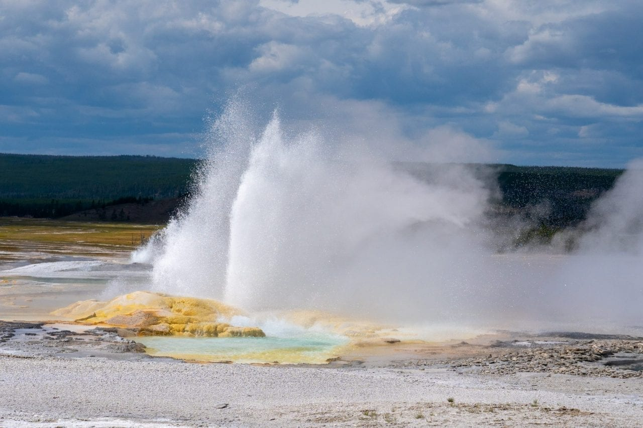 Eruption of Clepsydra Geyser in Lower Basin sends sulphur fumes and hot water several feet up in the air